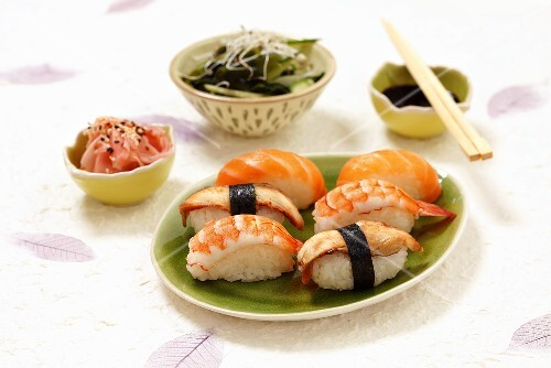 Nigiri sushi with salmon, eel and prawns, pickled ginger andseaweed salad