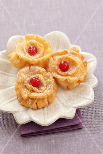 Deep-fried carnival roses with glace cherries