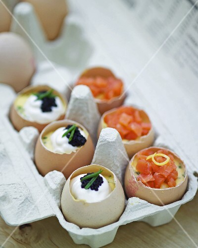 Boiled eggs with sour cream, caviar and salmon