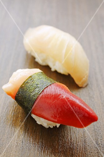 Two different nigiri sushi (shellfish and mackerel)
