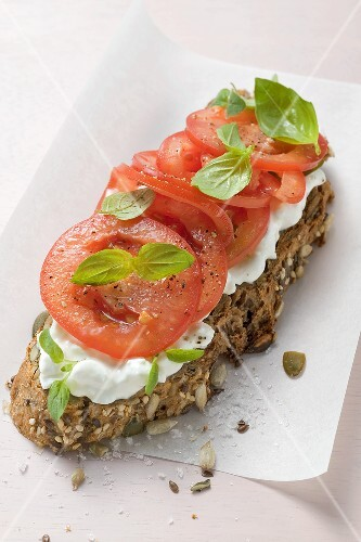 Soft cheese and tomatoes on bread