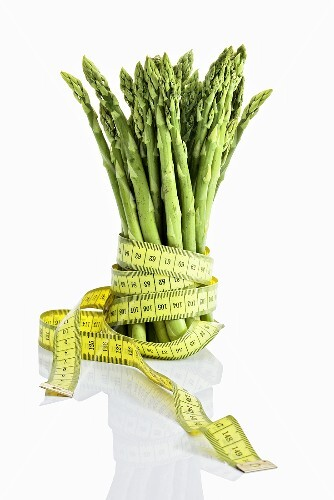Green asparagus with tape measure