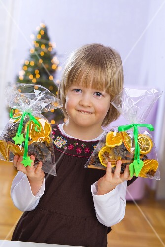 Little girl with bags of Christmas pot-pourri in her hands