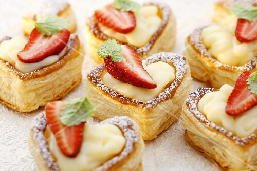 Heart-shaped vol-au-vents filled with custard & strawberries