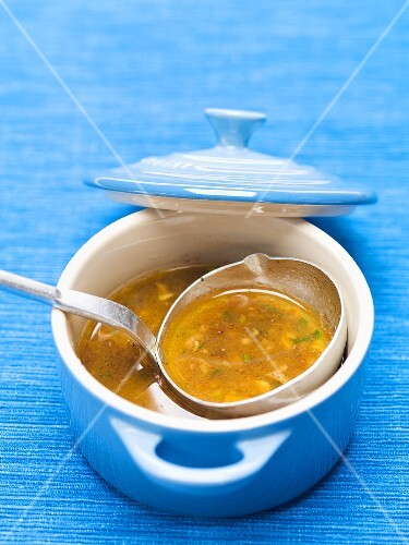 Meat soup in a blue pot