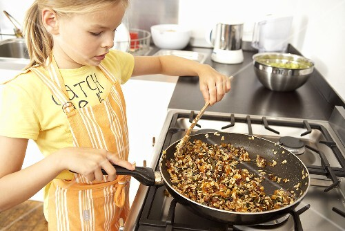Girl toasting muesli for muesli bars