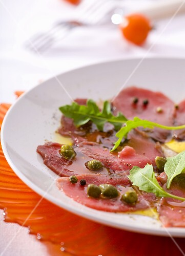 Beef carpaccio with rocket, capers, olive oil