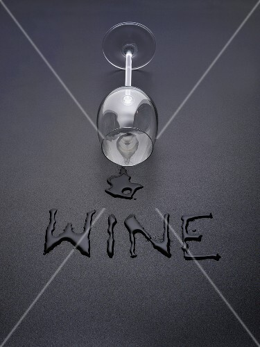 An upset white wine glass with the word 'Wine'