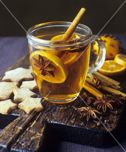Grog with orange slices and spices, star biscuits