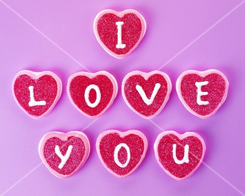 Heart-shaped sweets with letters spelling 'I love you'