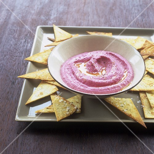 Beetroot dip with hummus and tortilla chips