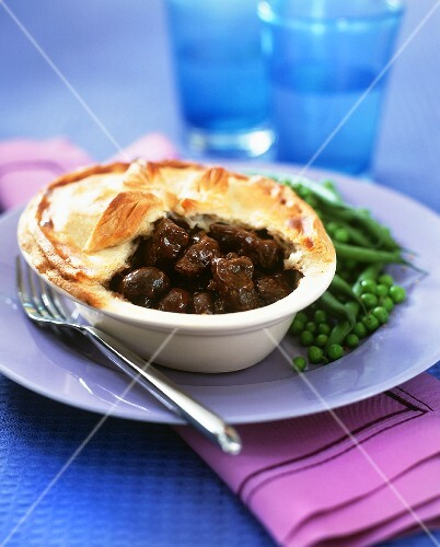 Steak and kidney pie with beans and peas