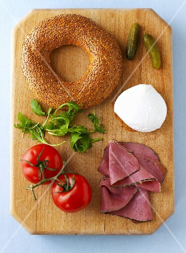 Ingredients for a bagel with pastrami