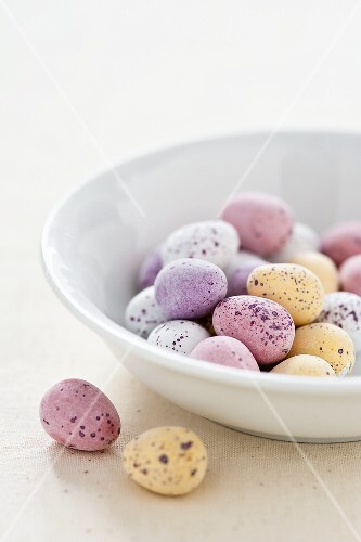 Chocolate eggs with pastel colored sugar glaze