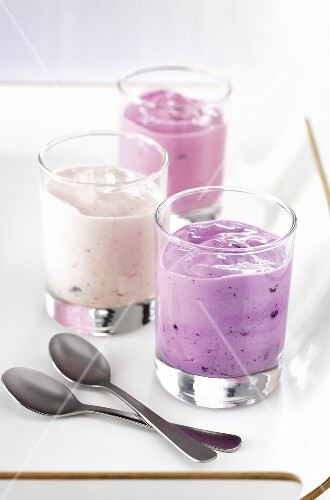 Three yogurts in glasses