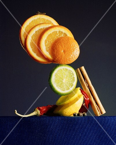 Citrus fruits in slices and various spices