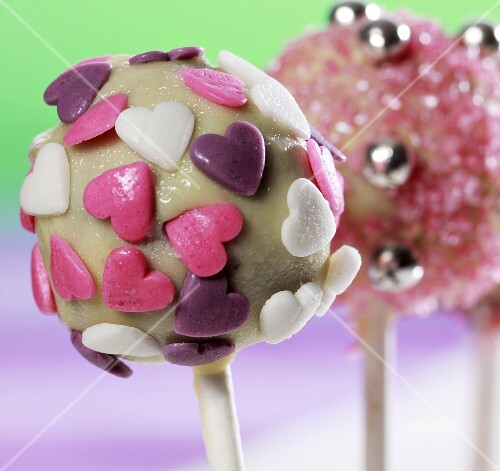 Cake pops, chilled and decorated with sugar strands