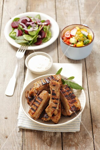 Grilled pork ribs with a horseradish dip and salad