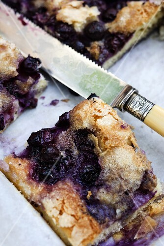 A slice of blueberry and butter cake