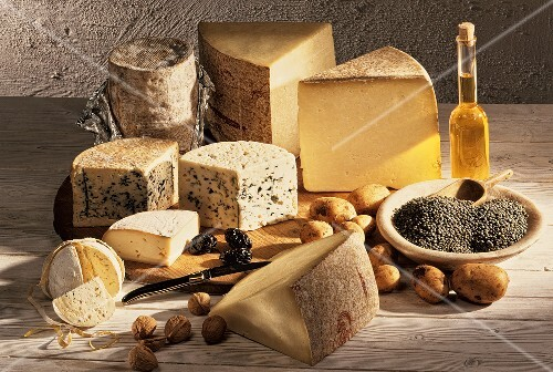 Various types of cheeses, potatoes and nuts