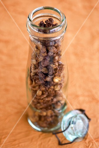 Roasted peanuts in a storage jar