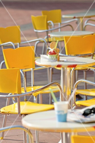 Chairs and tables in front of an ice cream cafe