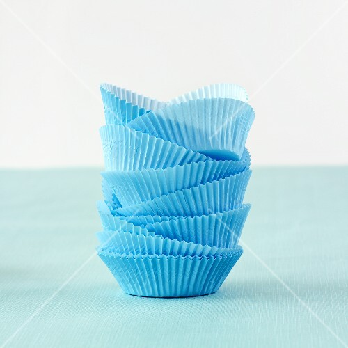A stack of blue paper cases