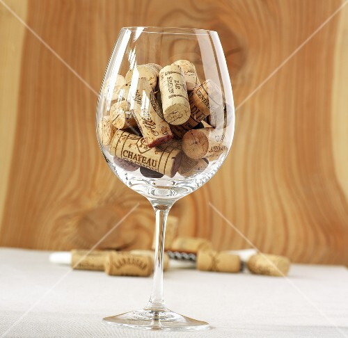 Wine corks in a red wine glass