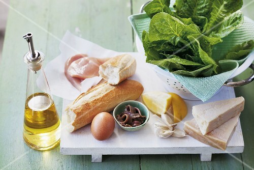 Ingredients for Caesar salad with chicken breast
