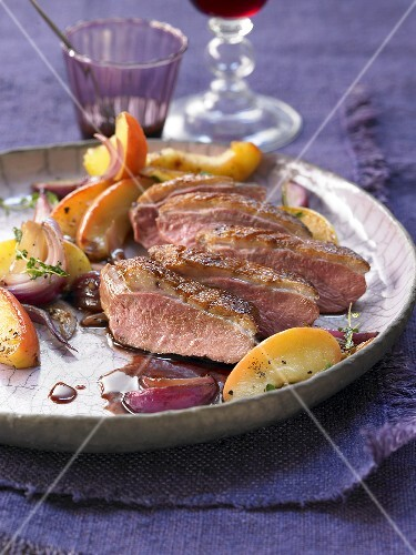 Duck breast with an apple and onion medley