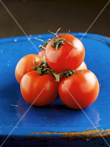 Tomatoes on a blue wooden chair