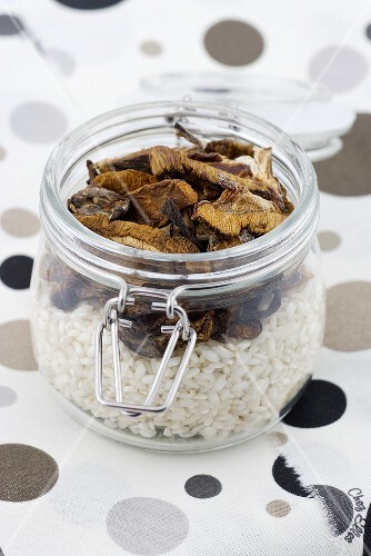 A jar of rice and dried mushrooms