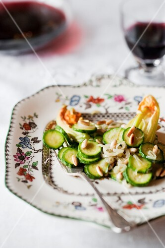 Courgette and courgette flowers with roasted pine nuts