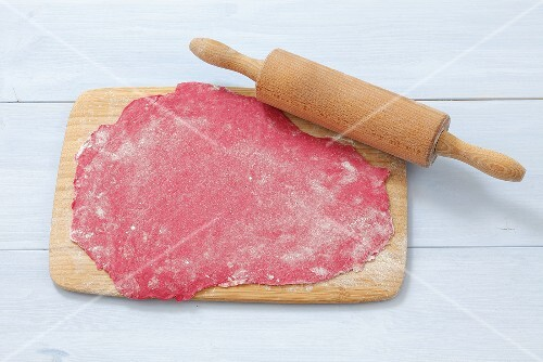 Rolled out noodle dough, pink