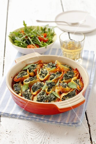 Conchiglie (pasta shells) with spinach filling and tomato sacue