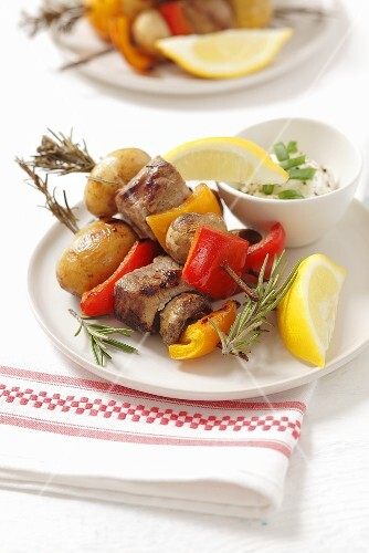 Pork fillet kebab with potatoes, pepper and mushrooms