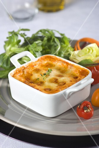Lasagne in a ramekin with a side salad