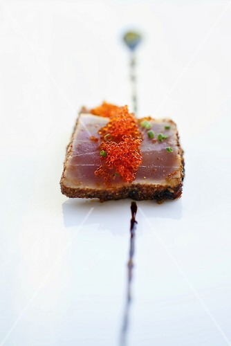 Salmon caviar on top of a slice of tuna