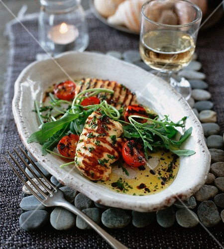 Grilled halloumi with wild rocket and tomatoes
