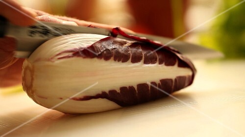 Cutting a radicchio in half