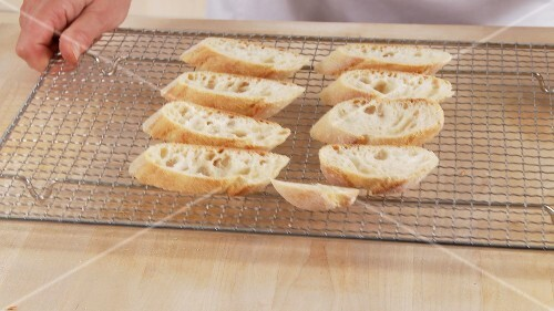 Ciabatta slices on an oven rack