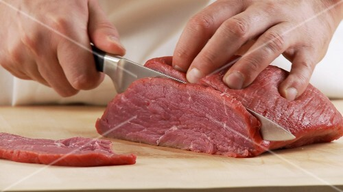 Veal shoulder being sliced
