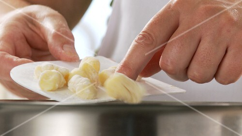Gnocchi being added to salt water