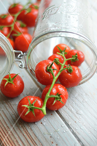 Bunch of tomatoes in a jar