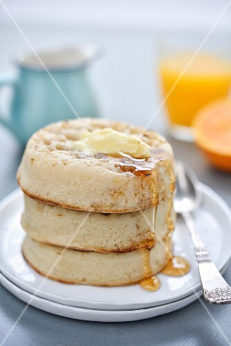 Crumpets with butter and golden syrup for breakfast