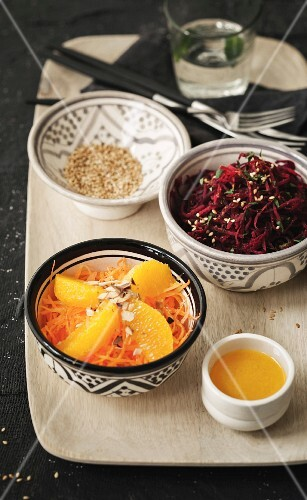 Raw grated beetroot with coriander and grilled sesame seeds, carrot, orange, orange blossom and almond salad