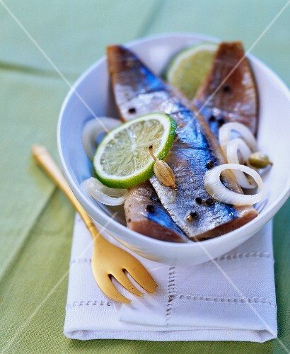 Pickled herrings with spices and lime
