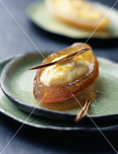 Confit orange boat with cream and cinnamon