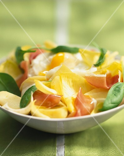 Chicory, raw ham, potato and egg salad
