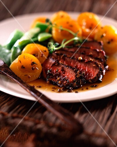 Ostrich steak with apricots
